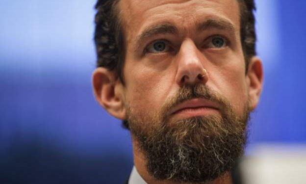Twitter boss posts Nigerian flag as protests held
